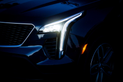 2019-Cadillac-XT4-Sport-Exterior-Dusk-010-headlight-with-full-forward-night-CS-Garage