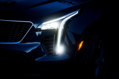 2019-Cadillac-XT4-Sport-Exterior-Dusk-011-headlight-with-full-forward-light-and-turn-light-CS-Garage