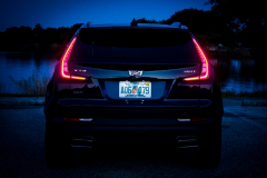 2019-Cadillac-XT4-Sport-Exterior-Dusk-012-rear-end-with-tail-lights-CS-Garage