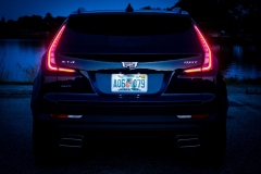 2019-Cadillac-XT4-Sport-Exterior-Dusk-013-rear-end-with-tail-lights-CS-Garage