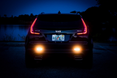 2019-Cadillac-XT4-Sport-Exterior-Dusk-015-rear-end-with-tail-lights-and-reverse-lights-CS-Garage