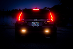2019-Cadillac-XT4-Sport-Exterior-Dusk-016-rear-end-with-tail-lights-and-reverse-lights-CS-Garage
