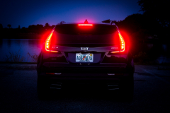 2019-Cadillac-XT4-Sport-Exterior-Dusk-017-rear-end-with-tail-lights-and-brake-lights-CS-Garage