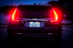 2019-Cadillac-XT4-Sport-Exterior-Dusk-018-rear-end-with-tail-lights-and-brake-lights-CS-Garage