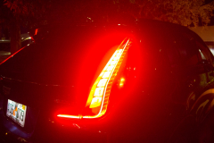 2019-Cadillac-XT4-Sport-Exterior-Dusk-021-tail-lights-detail-with-brake-lights-CS-Garage