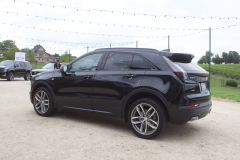 2019-Cadillac-XT4-Sport-Exterior-in-Stellar-Black-Metallic-at-Cadillac-Event-005-rear-three-quarters