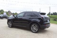 2019-Cadillac-XT4-Sport-Exterior-in-Stellar-Black-Metallic-at-Cadillac-Event-005-rear-three-quarters