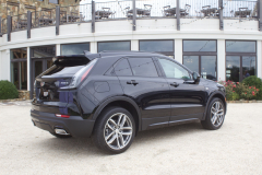 2019-Cadillac-XT4-Sport-Exterior-in-Stellar-Black-Metallic-at-Cadillac-Event-009-rear-three-quarters