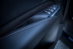 2019-Cadillac-XT4-Sport-Interior-Door-Panel-004-carbon-fiber-trim-and-red-stitching-CS-Garage