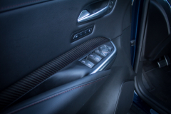 2019-Cadillac-XT4-Sport-Interior-Door-Panel-005-carbon-fiber-trim-and-red-stitching-CS-Garage