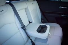 2019-Cadillac-XT4-Sport-Interior-Second-Row-004-armrest-and-cupholder-CS-Garage