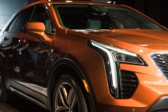2019 Cadillac XT4 exterior live reveal 005 front three quarters headlight
