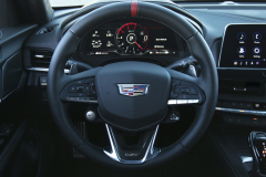 2022-Cadillac-CT4-V-Blackwing-Interior-Level-2-002-Jet-Black-cockpit-steering-wheel-with-carbon-fiber-trim-and-red-stripe-digital-gauge-cluster-Cadillac-logo