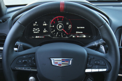 2022-Cadillac-CT4-V-Blackwing-Interior-Level-2-003-Jet-Black-cockpit-steering-wheel-with-carbon-fiber-trim-and-red-stripe-digital-gauge-cluster-Cadillac-logo