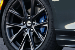 2022-Cadillac-CT4-V-First-Drive-Exterior-028-front-wheel-Cadillac-logo-on-wheel-cap-blue-V-brake-caliper