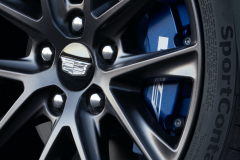 2022-Cadillac-CT4-V-First-Drive-Exterior-029-front-wheel-Cadillac-logo-on-wheel-cap-blue-V-brake-caliper