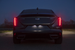 2020-Cadillac-CT4-350T-Premium-Luxury-Exterior-012-rear-end-at-night-with-taillamps