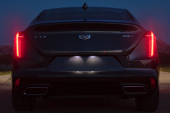 2020-Cadillac-CT4-350T-Premium-Luxury-Exterior-013-rear-end-at-night-with-taillamps