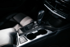 2020-Cadillac-CT4-Sport-Sedan-Interior-008-center-console-shifter-cupholders-armrest