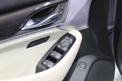 2019 Cadillac CT5 Sport - 2019 New York International Auto Show - Interior 009 - driver side inside door panel and trim and window switches