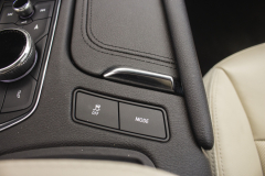 2020-Cadillac-XT5-Sport-Interior-016-drive-mode-button-traction-control-button-sliding-cupholder-cover-panel