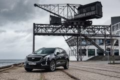 2020-Cadillac-XT5-Sport-in-Denmark-with-Russian-License-Plates-Exterior-005-black-front-three-quarters-on-ship-yard