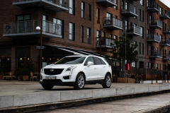 2020-Cadillac-XT5-Sport-in-Denmark-with-Russian-License-Plates-Exterior-006-white-front-three-quarters-Goteborg-plats