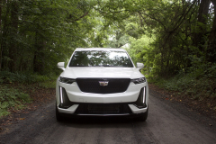 2020-Cadillac-XT6-Sport-Exterior-XT6-Drive-Forest-001-front-end