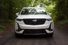 2020-Cadillac-XT6-Sport-Exterior-XT6-Drive-Forest-002-front-end