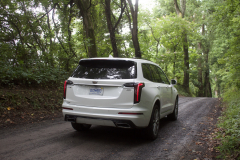 2020-Cadillac-XT6-Sport-Exterior-XT6-Drive-Forest-006-rear-three-quarters