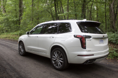 2020-Cadillac-XT6-Sport-Exterior-XT6-Drive-Forest-010-rear-three-quarters