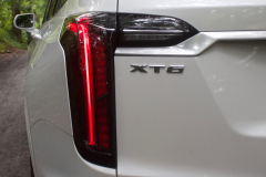2020-Cadillac-XT6-Sport-Exterior-XT6-Drive-Forest-012-tail-light-with-XT6-badge-logo