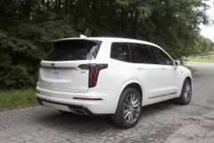 2020-Cadillac-XT6-Sport-Exterior-XT6-Drive-Forest-018-rear-three-quarters
