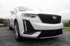2020-Cadillac-XT6-Sport-Exterior-XT6-Drive-Winery-008-front-three-quarters-headlight-and-grille-focus