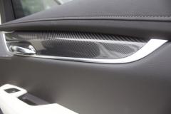 2020 Cadillac XT6 Sport Interior First Drive 019 carbon fiber door insert