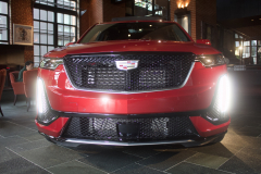 2020-Cadillac-XT6-Sport-with-Platinum-Package-Red-Horizon-Tintcoat-XT6-First-Drive-Lobby-002-Front-end-Cadillac-Logo-Grille-Headlights