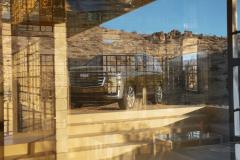 2021-Cadillac-Escalade-Premium-Luxury-Exterior-002-front-three-quarters-reflection