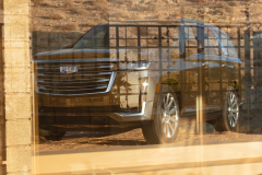 2021-Cadillac-Escalade-Premium-Luxury-Exterior-003-front-three-quarters-reflection