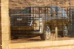 2021-Cadillac-Escalade-Premium-Luxury-Exterior-003-front-three-quarters-reflection