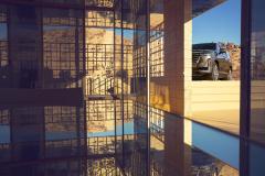 2021-Cadillac-Escalade-Premium-Luxury-Exterior-004-front-three-quarters-peaking
