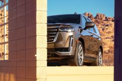 2021-Cadillac-Escalade-Premium-Luxury-Exterior-005-front-three-quarters-peaking