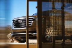 2021-Cadillac-Escalade-Premium-Luxury-Exterior-006-front-three-quarters-peaking