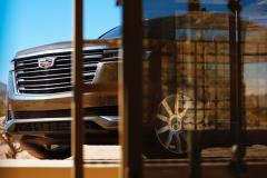 2021-Cadillac-Escalade-Premium-Luxury-Exterior-007-front-three-quarters-peaking