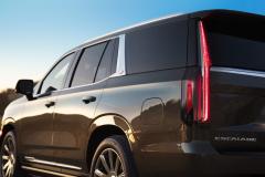2021-Cadillac-Escalade-Premium-Luxury-Exterior-021-rear-three-quarters-with-tail-lamp