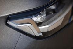 2021-Cadillac-Escalade-Premium-Luxury-Exterior-030-headlamp-with-Cadillac-script