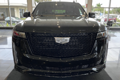 2021-Cadillac-Escalade-Sport-Onyx-Package-Black-Raven-Exterior-010-front-end-grille-headlights-monochromatic-Cadillac-logo