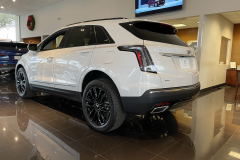 2021-Cadillac-XT5-Sport-400-with-20-inch-S2K-wheels-in-Gloss-Black-Exterior-006-rear-three-quarters