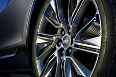2023-Cadillac-Lyriq-Exterior-033-22-inch-Polished-Gloss-Black-alloy-wheel-with-split-spoke-reverse-rim-pattern-Cadillac-logo-on-center-cap-lug-nuts