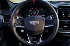 2022-Cadillac-CT5-V-Blackwing-Interior-Level-3-002-Jet-Black-cockpit-steering-wheel-with-carbon-fiber-accents-and-red-stripe-digital-gauge-cluster