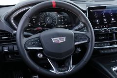 2022-Cadillac-CT5-V-Blackwing-Interior-Level-3-010-cockpit-steering-wheel-with-carbon-fiber-accents-and-red-stripe-digital-gauge-cluster